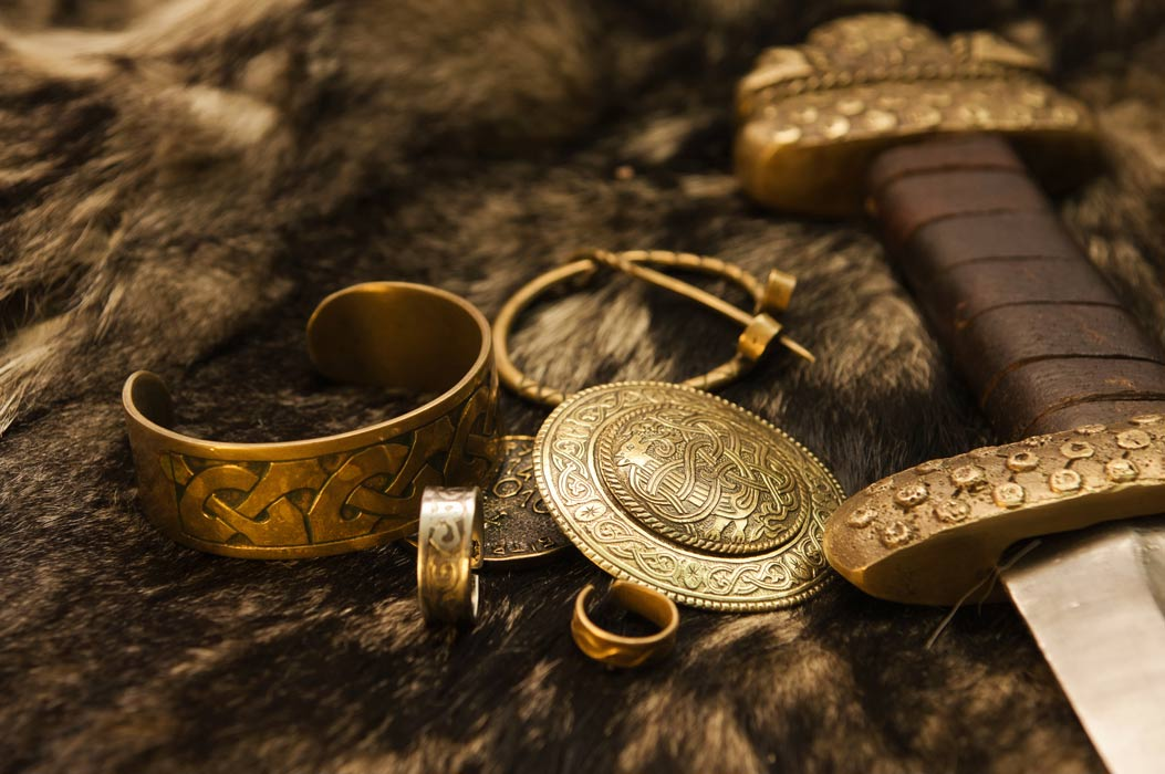 Viking jewelry and sword representations on fur