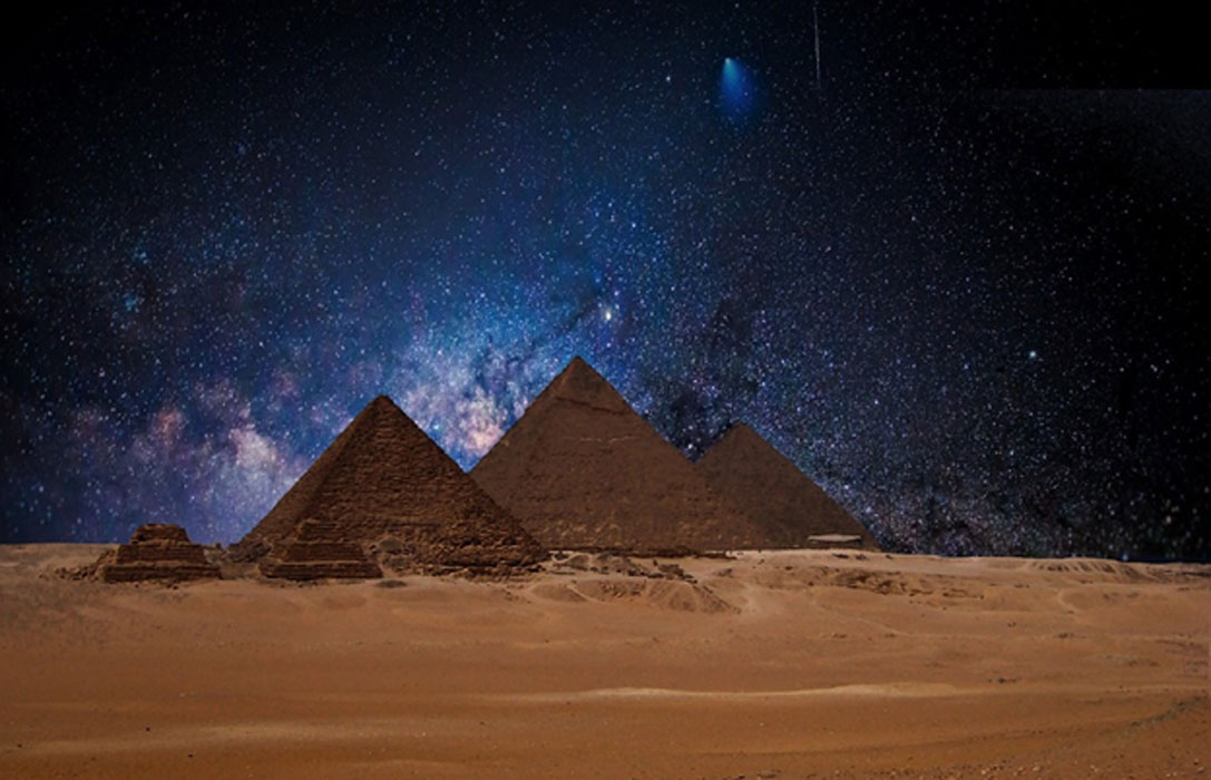 Egyptian pyramids under a night sky. Several researchers believe astronomical alignments at this site point to signs of an ancient advanced civilization.