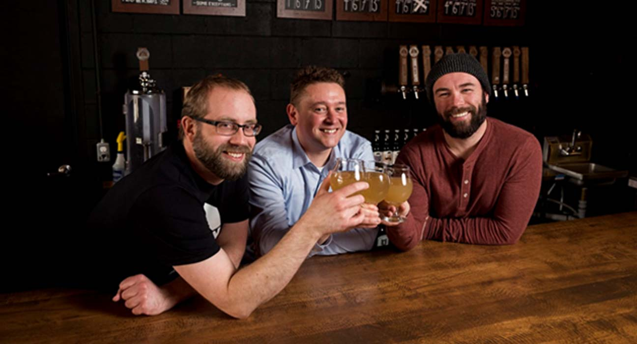 Left to right- Barn Hammer Brewing Company Head Brewer Brian Westcott, Matt Gibbs of the University of Winnipeg and Barn Hammer owner Tyler Birch teamed up to re-create an ancient beer. THE CANADIAN PRESS/David Lipnowski/The Conversation