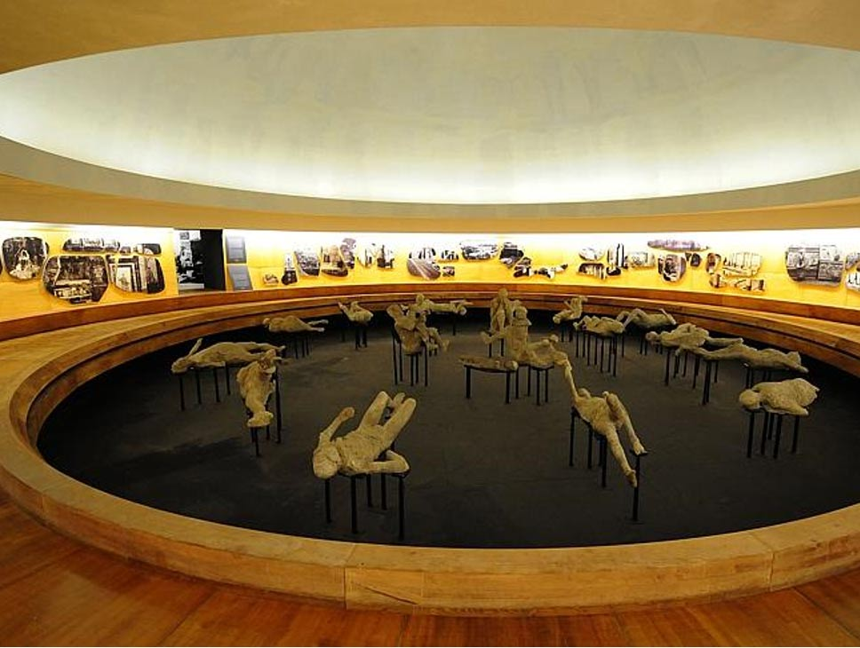 The bodies of about 20 victims of the volcanic eruption of 79 AD are on display through September 27, 2015, in an ancient amphitheater.
