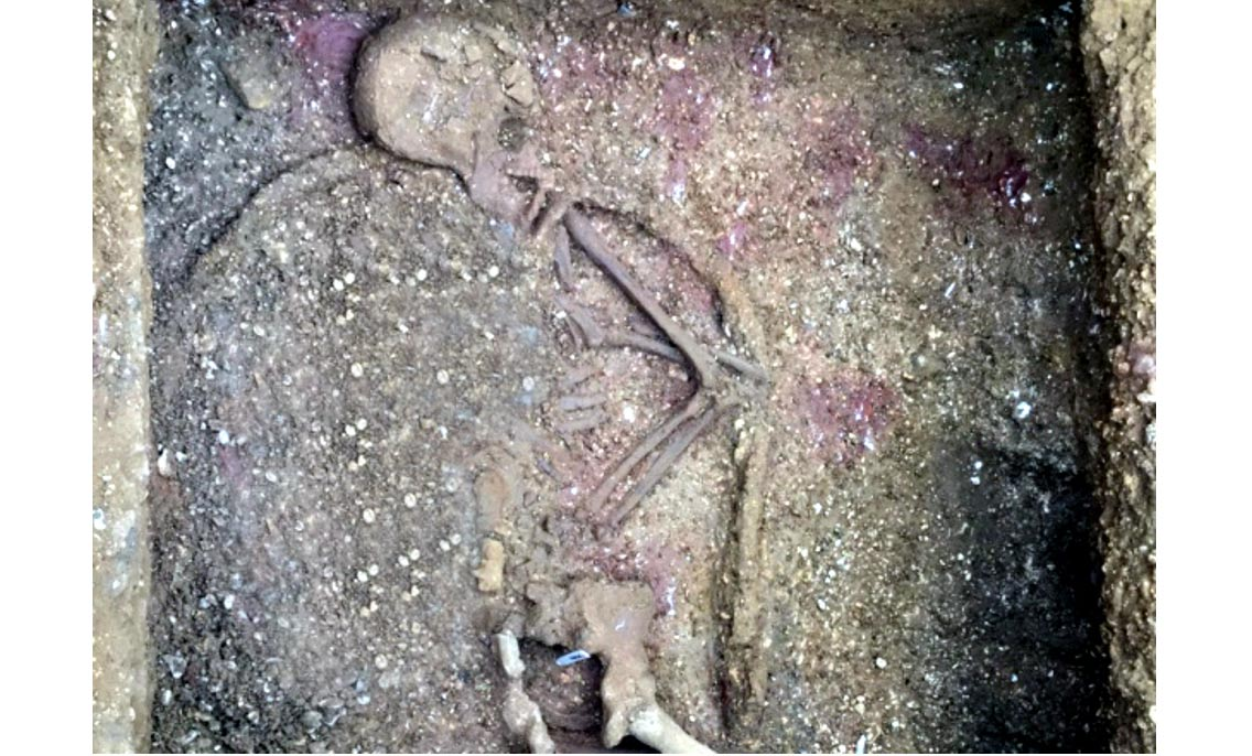 Ancient skeleton of a man buried with a shield in England