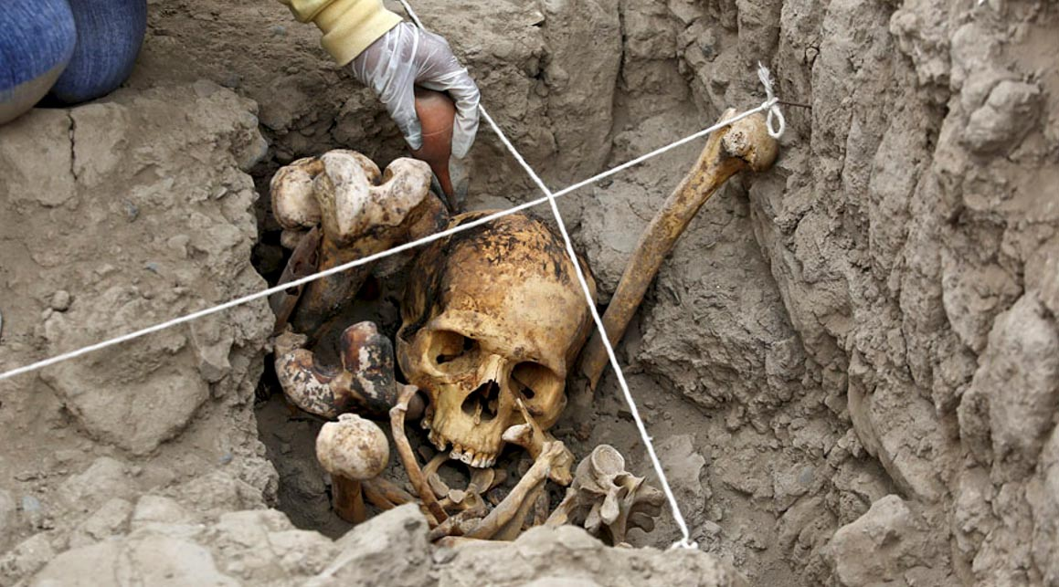 An archaeologist working in one of the tombs found at the Huaca Pucllana archaeological site in Lima, Peru.