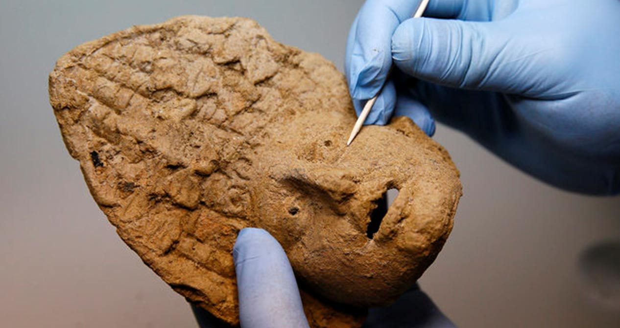 A baked clay theater mask that was discovered among the grave goods provides information about the people whose bodies were buried in the chamber.