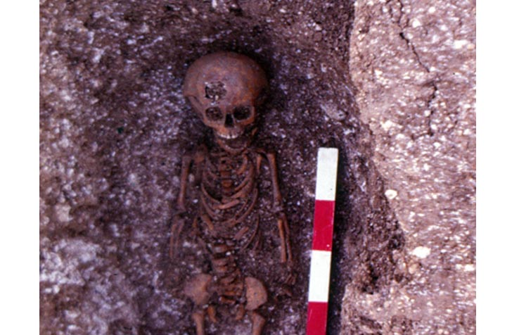 Featured image: A child burial at the abandoned medieval village of Hatch, which was excavated in the winter of 1984 and 1985.