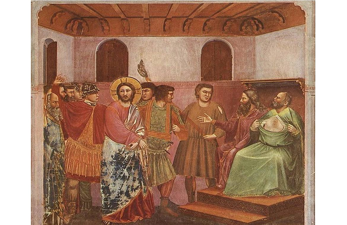 The High Priest is depicted tearing his robe in grief at Jesus' perceived blasphemy. Was this a calculated move to stop secrets from being revealed? Fresco, Giotto di Bondone (1267-1337).