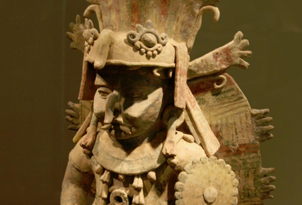 Terra cotta image of Maya Rain God Chac at San Francisco's de Young museum.