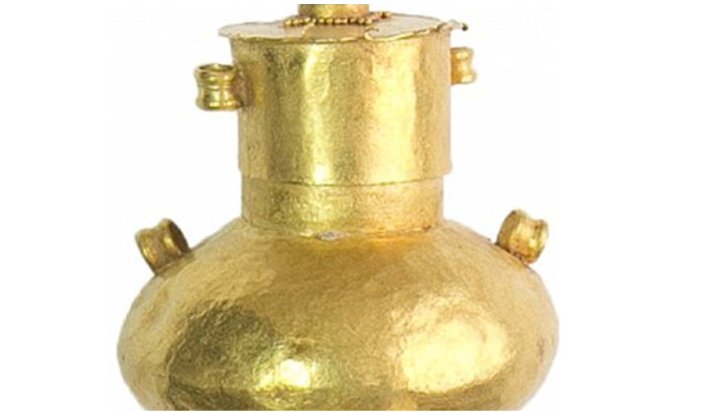 This gold vial may have contained incense. Its contents, which were fossilized, will be analyzed.