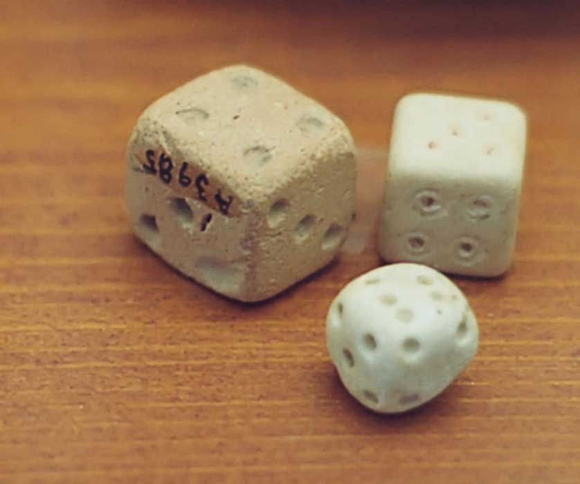 These Roman dice are not the sum of opposite sides of seven and are not symmetrical.