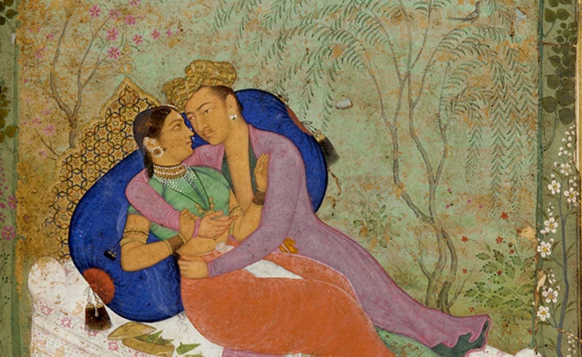 Kama Sutra couple on bed