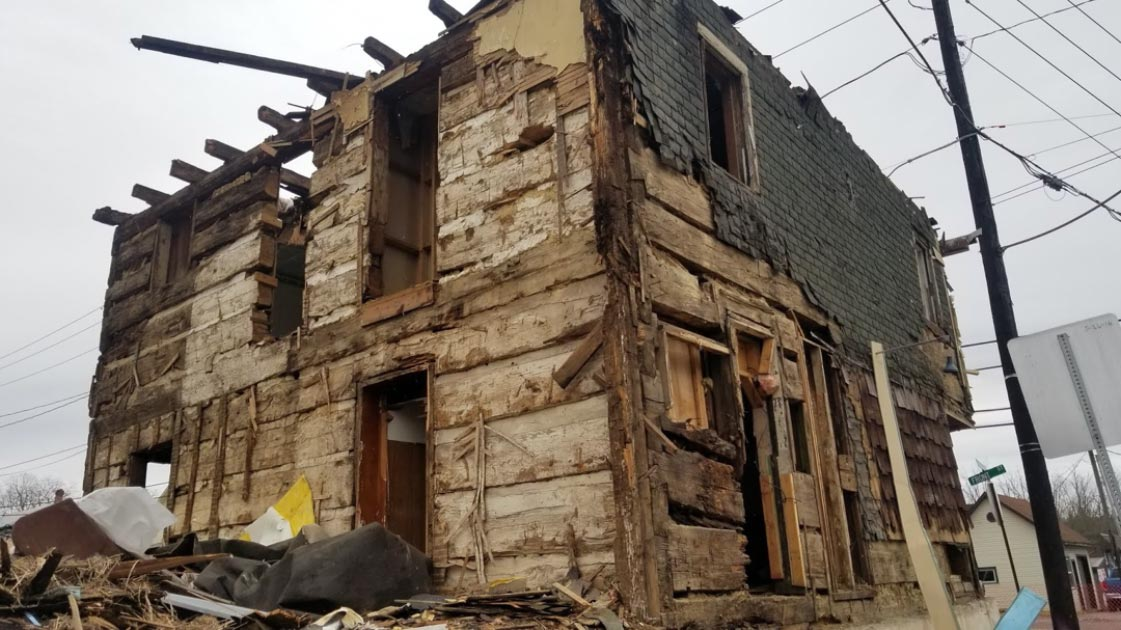 Revolutionary era log house revealed by demolishers.            Source: Valley Girl Views