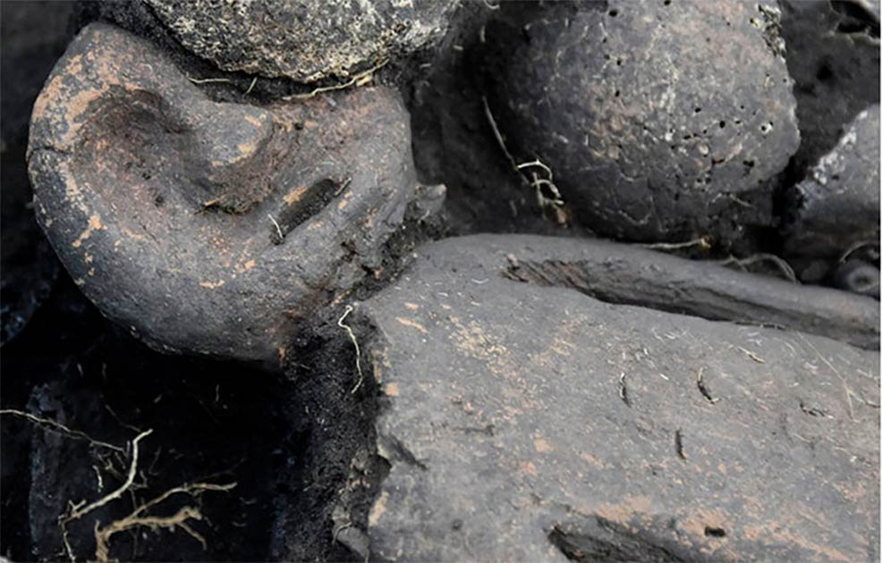 5,000-Year-Old Masked Figurine Found in Siberian Mass Grave
