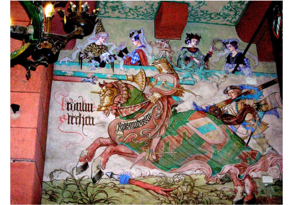 A neo-Gothic mural by Léo Scnug in a French castle depicting a medieval knight about to joust and four women in the audience, painted in the 1910s.