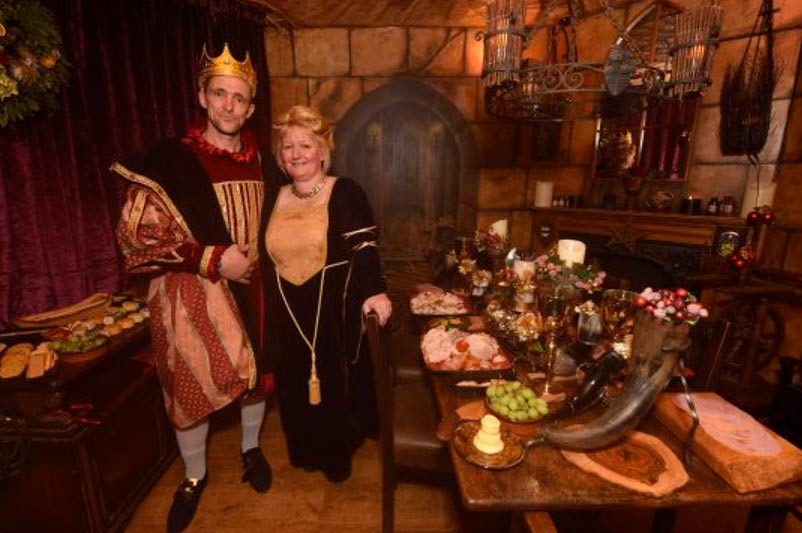 Jayne and Martin Townley at their Middle Ages themed house hosting a medieval banquet