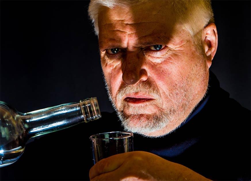 Man drinking alcohol. Credit: Rainer Fuhrmann / Adobe Stock