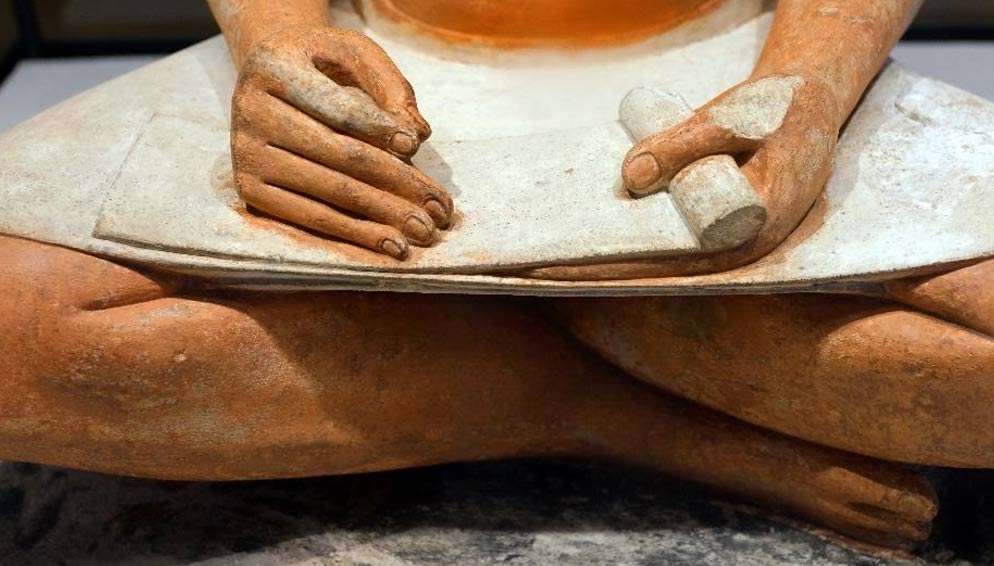Detail of a seated Scribe sculpture