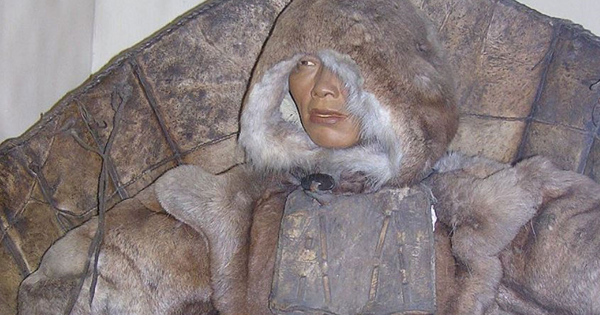 econstruction of a Siberian woman wearing laminar armor of hardened leather enforced by wood and bones worn by the Chukchi, Aleut, and Chugach people.