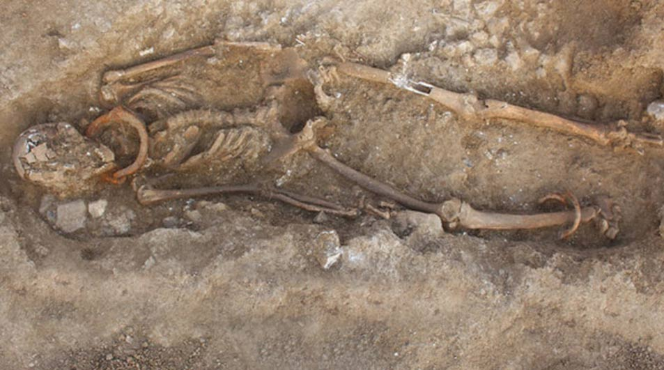 Shackled adult and child skeletons unearthed in ancient Roman necropolis in France