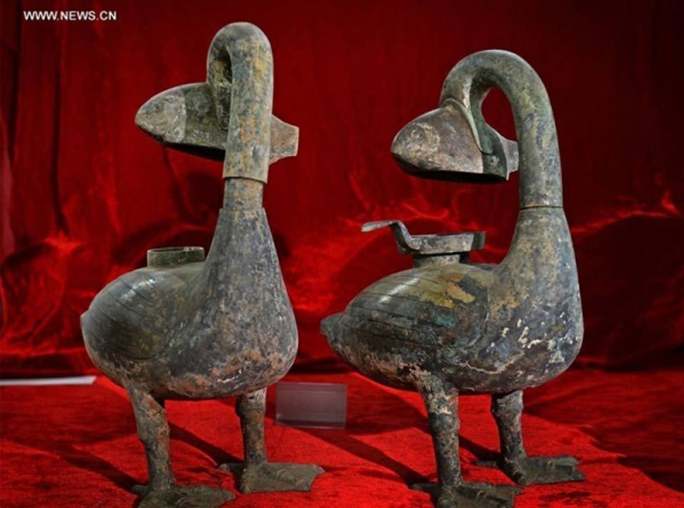 Chinese archeologists excavated two ancient smoke-absorbing bronze lamps that are believed to be about 2,000 years old. Experts said the artifacts may have been the world's first eco-friendly lamps.