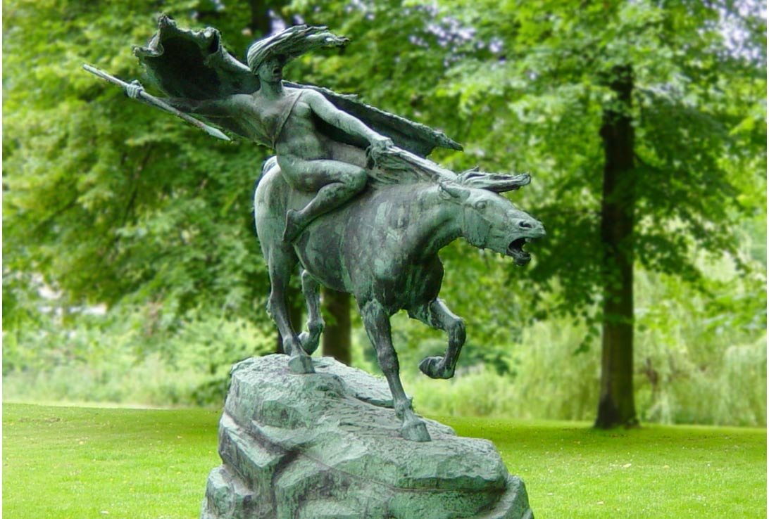 A statue of a Norse valkyrie, or battle maiden, on a horse in a park in Copenhagen, Denmark