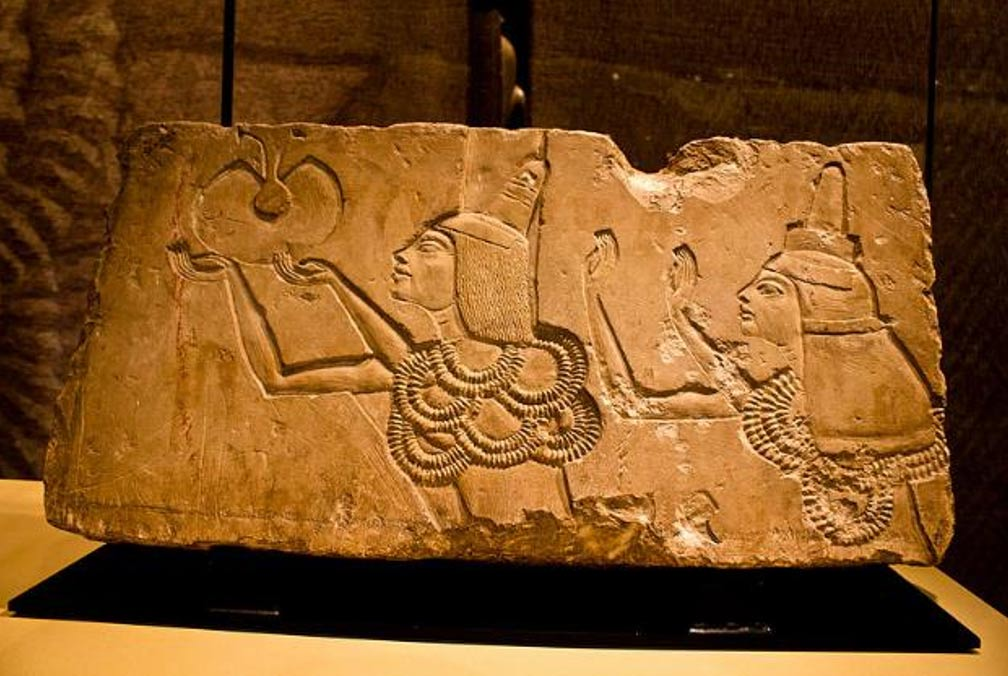 A stone block shows Ay receiving the 'Gold of Honor' award in his Amarna tomb from Akhenaten.