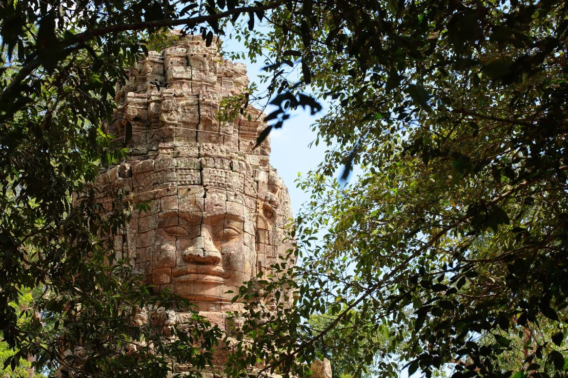 Monumental stone face at Bayon Temple, Cambodia.