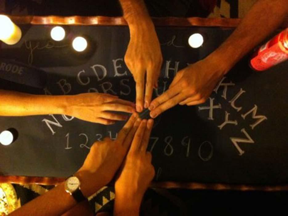 People using a Ouija board