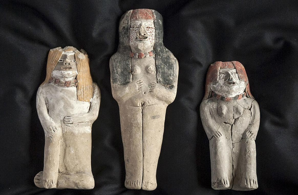 The three statues unearthed by archaeologists in Peru.