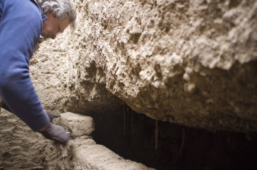 Professor Stuart Tyson Smith opens an intact tomb with the coffined, mummified burial of an elderly woman inside.