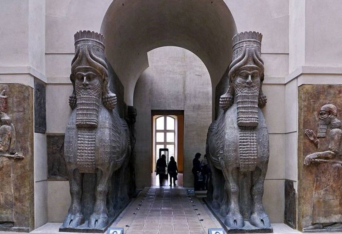 Human-headed winged bulls guarding a door in Dur-Sharrukin.