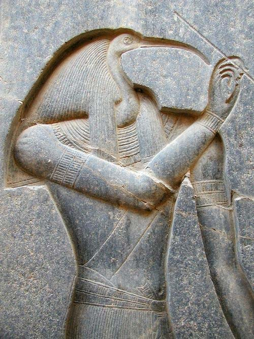A figure of Thoth carved on the back of the throne of the seated statue of Rameses II.
