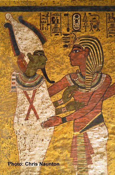 In the final scene on the north wall, Tutankhamun is shown wearing the nemes headcloth followed closely by his Ka (not in picture), as Osiris welcomes him into the Netherworld with an embrace.