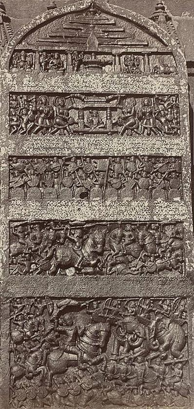 An elaborate, five panel Hero Stone from 12th century with carvings depicting battle scenes.