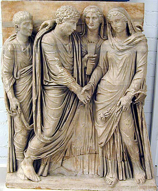 Fragment from the front of a sarcophagus showing a Roman marriage ceremony.