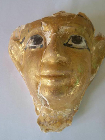 The funerary mask found in one of the tombs