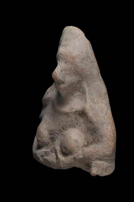 The fertility goddess amulet found by the 11-year-old boy in the Negev region of Israel, which is seven centimeters (2.7 inches) tall and six centimeters (2.3 inches) wide. (IAA)