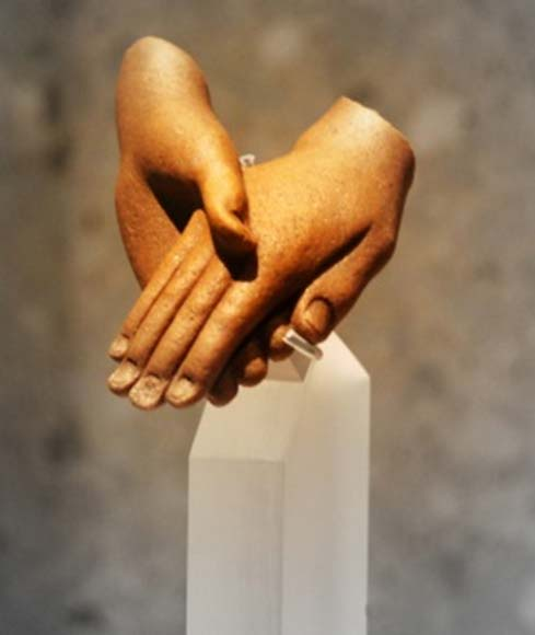 Detail from a group statue: Akhenaten and Nefertiti clasp each other's hands in a depiction of tender affection. Neues Museum, Berlin.