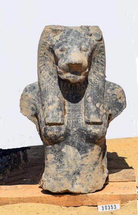 A head and torso of one of the statues.