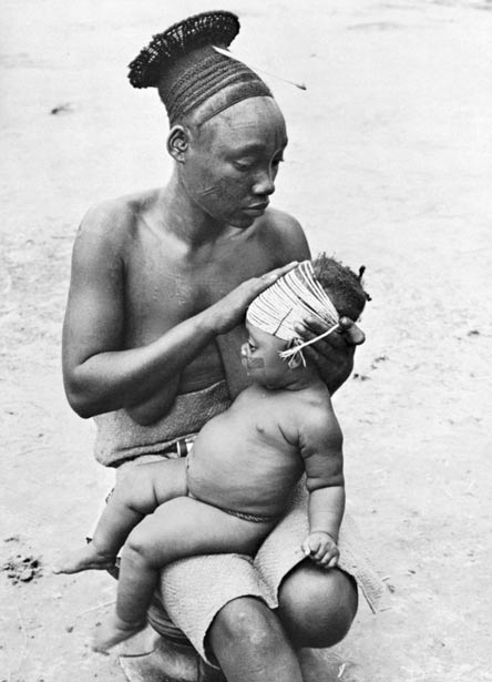 A photo depicting the practice of head binding with rope