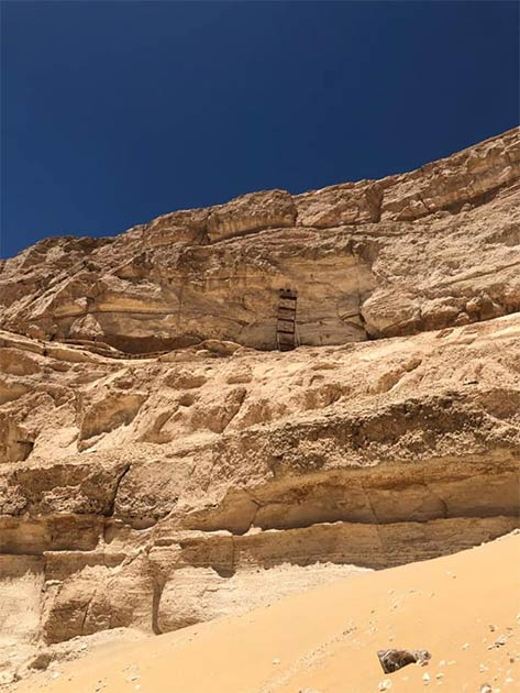 "The openings discovered high up in a cliff face are ""entrances to carved out chambers, which probably have sacred religious importance."" (Ministry of Tourism and Antiquities)"