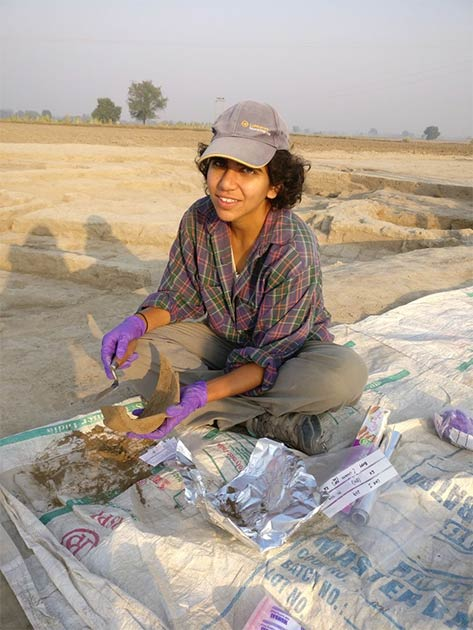 Lead author Akshyeta Suryanarayan sampling pottery for residue analysis in the field. Photo credit: Akshyeta Suryanarayan