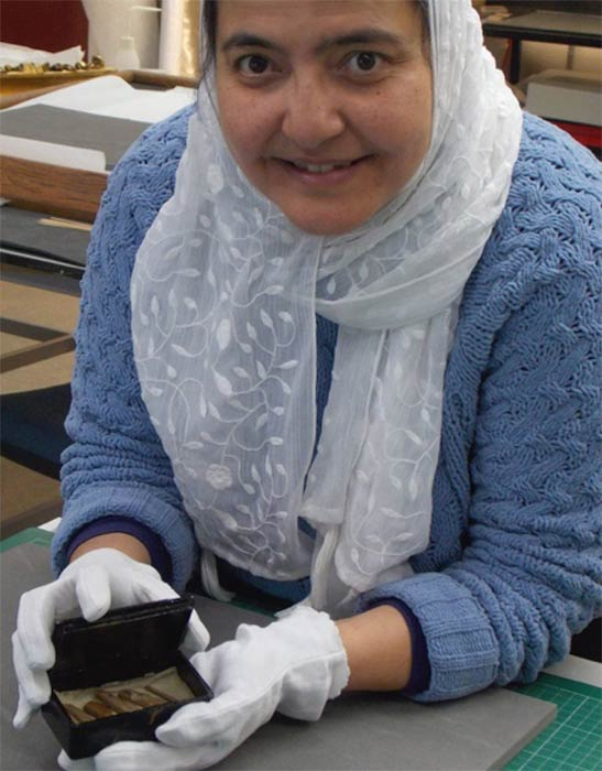 Curatorial assistant, Abeer Eladany, spent ten years working at the Egyptian Museum in Cairo before coming to the University of Aberdeen. She discovered the pyramid relic, made up of cedarwood fragments, inside a cigar box. (University of Aberdeen)