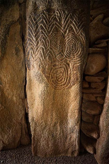 Elaborate decorations carved into a stone inside the chamber of Newgrange, one of the Irish megalith monuments. Credit: Ken Williams, shadowsandstone.com
