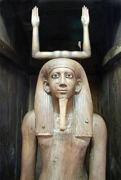 Well-preserved wooden Ka statue of the Pharaoh Hor I, 13th Dynasty, 1777-1775 BC, showing the upraised arms that symbolized magic. (Jon Bodsworth)