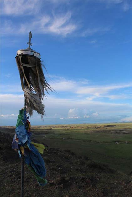 A horse-hair banner adorns a hillside monument in central Bayankhongor province, Mongolia. (William Taylor)