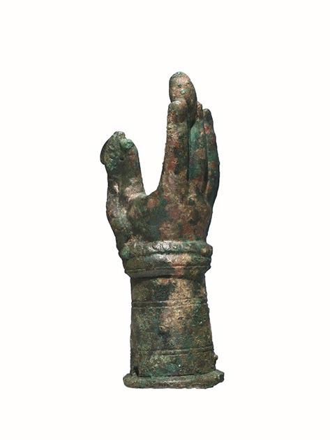 Rimini, Domus del Chirurgo, votive hand linked to the cult of Iuppiter Dolichenus. It is an empty lost wax bronze sculpture depicting an open right hand, rendered in a naturalistic way, with grooves that outline the nails and the inner folds of the fingers. A scaly snake with a crested head wraps itself around the wrist and rises along the thumb. In the upper part, between the index and middle fingers, there is an ovoid element, similar to a bud with its stem blocked by the fingers. (Image courtesy of Ministero per i Beni e le Attività Culturali - Soprintendenza Archeologia, Belle Arti e Paesaggio per le Province di Ravenna, Forlì-Cesena e Rimini).