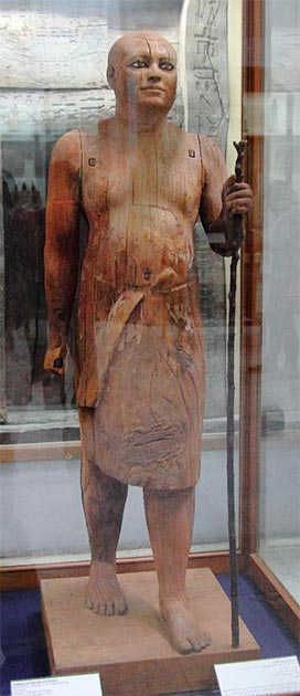 Sycamore-wood statue of Chief Lector Priest Ka-Aper, 5th Dynasty (~2500 BC), holding a long staff. (Djehouty/CC BY SA 4.0)