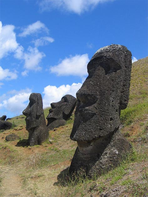 "The now world-famous, gigantic Easter Island ""Moai"" heads - most are accompanied with even larger bodies buried under the ground. (Public Domain)"
