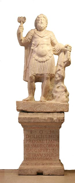 Jupiter Dolichenus as a Roman commander, but with the standard weapons of the god: a double-axe in his right hand, and a lightning bolt in his left. From Carnuntum, early 3rd-century. (MatthiasKabel/CC BY SA 3.0)