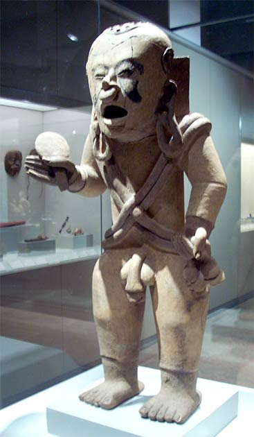 """The god Xipe Totec was known as """"Our Lord the Flayed One,"""" and figured prominently in Aztec violence rituals and sacrifices. This ceramic figure dates to 100-400 AD. (Simon Burchell / CC BY-SA 3.0)"""