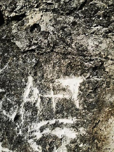 The initials scratched into the 1,300-year-old Maya temple. (Vinicio Alba Ruiz)